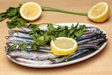 engraulis: Mediterranean anchovies with parsley and lemon. Cooking Mediterranean food