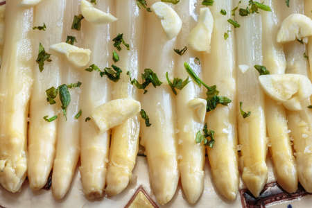 Delicious and tender asparagus seasoned with garlic and parsley. Fresh and healthy food.