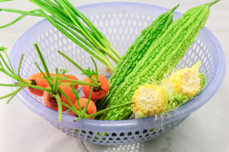 close up of onions in a basket: White background studio shoot of Vegetables