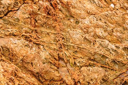 amounts: The seaside lava containing large amounts of red iron Stock Photo