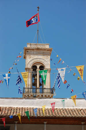 a belfry with colorfoul flags in hydra island in greece