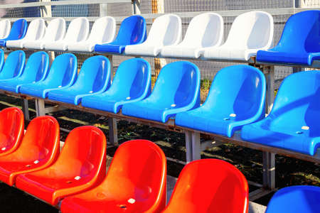 Close-up and selective focus of empty seats in sport stadium. Concept of canceling competitions due to the pandemic. Conducting sports events in compliance with all safety rules