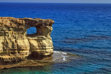 Gap in the rock over sea  Famous coastal landscape near Ayia Napa, Cyprus Stock Photo