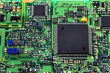 Digital hardware closeup. Microchips assembly on the circuit board macro Stock Photo