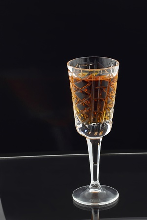 A glass of strong liqueur on a dark background  Chaser