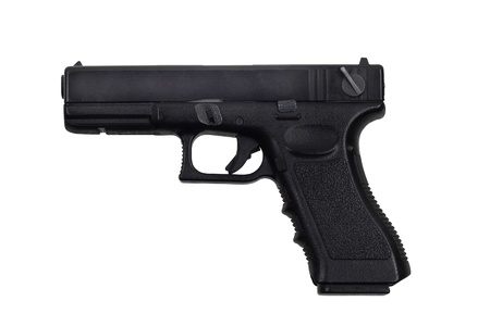 Black handgun isolated on white photo