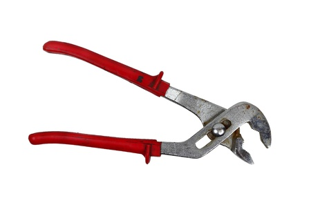Rusty metallic wrench pliers with red handles isolated on white photo