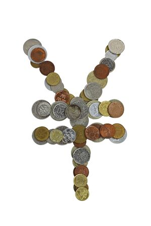 Japanese yen or chinese yuan sign, laid out with small coins of different countries, mostly obsolete