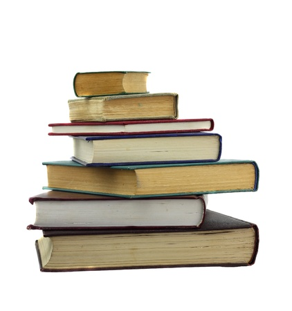 Books of differend size in irregular stack isolated on white Stock Photo
