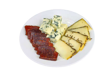 Blue cheese and piquant cheese with fig jam slices on a plate isolated on white