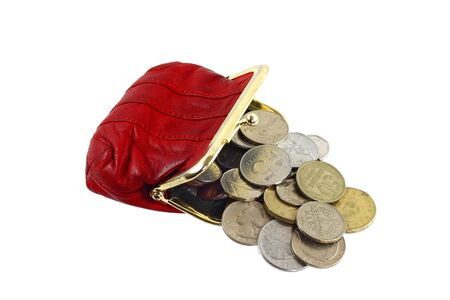 Red purse with change coins isolated on white