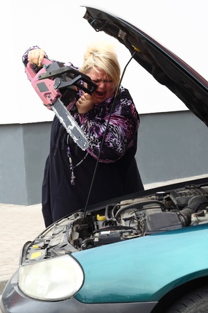 Plump blond woman solves her problems with technique in a very radical way using her lovely pink chainsaw. The revolt against cars.