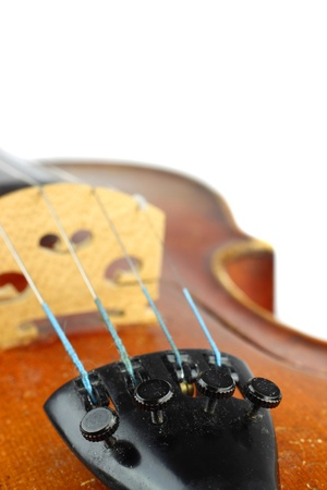 Violin macro closeup. View on tailpiece with fine tuners and strings. Bridge and upper bout in background Stock Photo