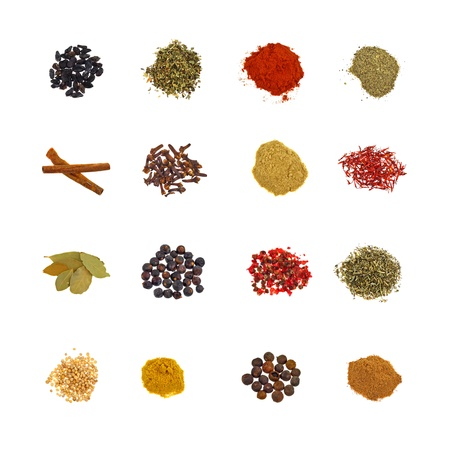 Set of 16 colorful spices in piles on white