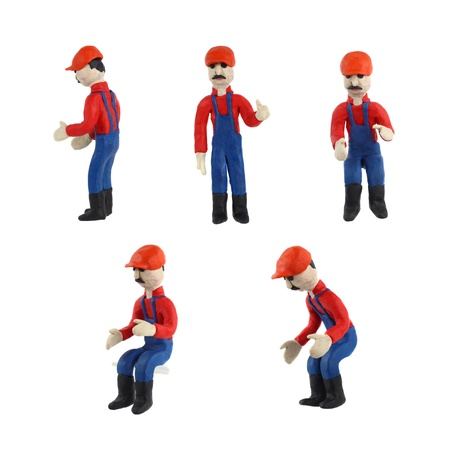 Plasticine figurine of a man in working clothes set in different poses Stock Photo