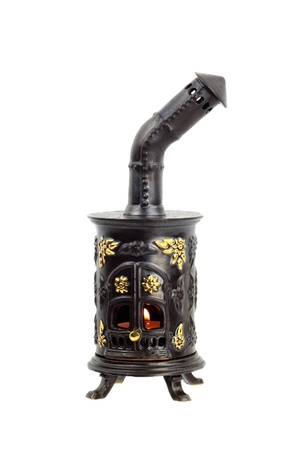 Decorative furnace with a lighted candle inside for the holiday table decoration isolated on white background Stock Photo