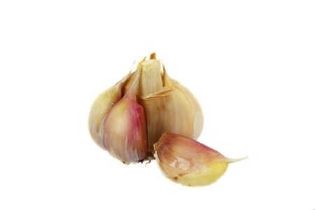 Garlic head with one slice separated isolated on white background