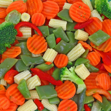 Frozen vegetables. Blend of green beans and broccoli, red carrots and paprika, white sweet corn. Vegetarian food background Stock Photo