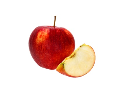 Whole red apple and a slice near it isolated on white background Stock Photo - 17218265