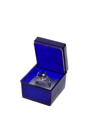 Gift box containing a silver ring with sapphire. Isolated on white background photo