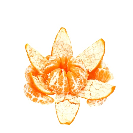 Tangerine opened in shape of flower with tangerine slices around isolated on white background photo