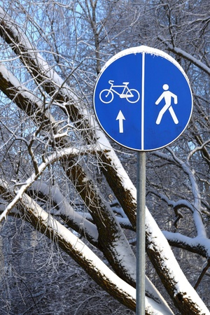 Blue road sign on the winter natural background photo