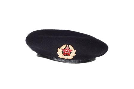 Uniform headgear of soviet special forces or marines  Black wool beret with a badge  Isolated on white background Stock Photo - 17326997