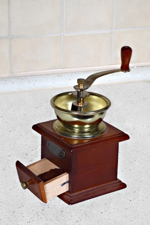 Vintage coffee grinder on the kitchen table photo