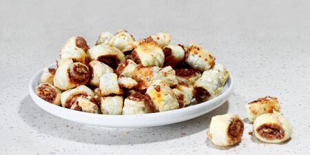 Dish of cinnamon buns on gray table