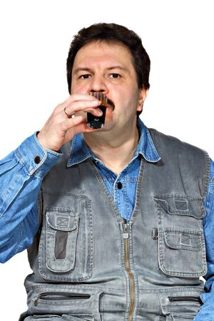 Middle age man drinks a shot of strong alcohol Stock Photo