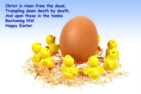 Yellow chickens dance around big egg under blue sky