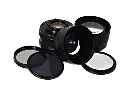 Photo lens and filters in pile isolated on white background