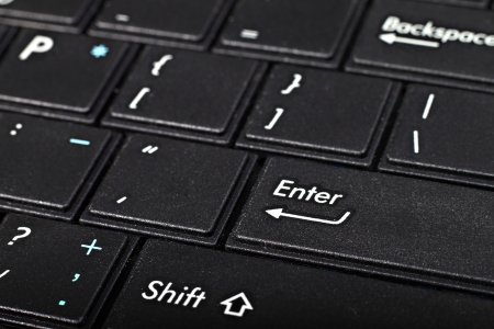 Netbook keyboard, black with white symbols. Macro closeup Stock Photo - 18233543