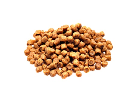 Dried pet food in pile isolated on white background
