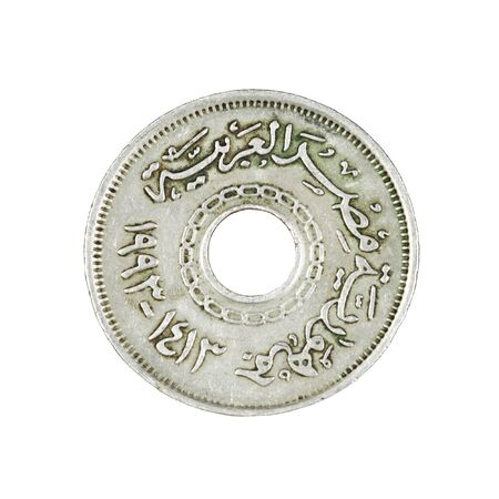 Egyptian coin with hole isolated on white background Stock Photo