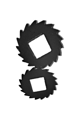 Two black cogwheels in interlocking with distorted perspective isolated on white background photo