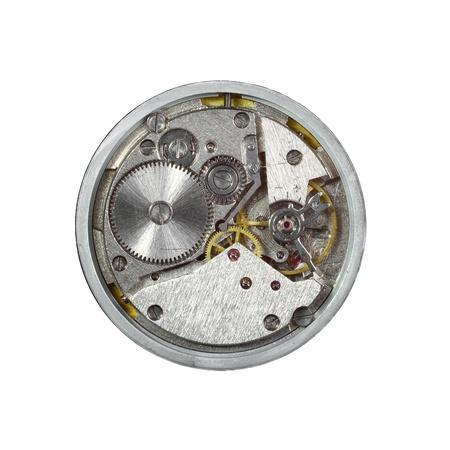 Round mechanical clockwork macro closeup isolated on white background Stock Photo