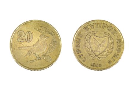 Old shabby 20 cents coin from Cyprus  Obsolete 1 5 part of Cyprus pound  Both sides isolated on white bacground Stock Photo