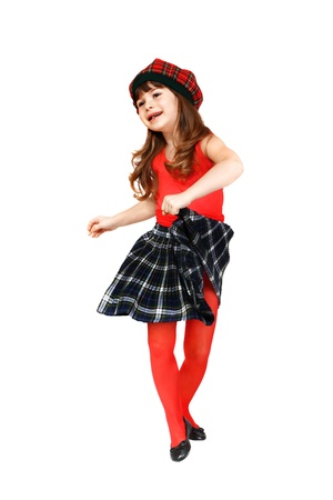 Cute little girl dances dressed in Scottish style  Portrait isolated on white background