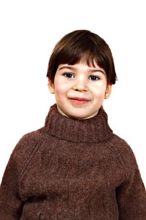 Portrait of cute little girl in wool sweater on white background