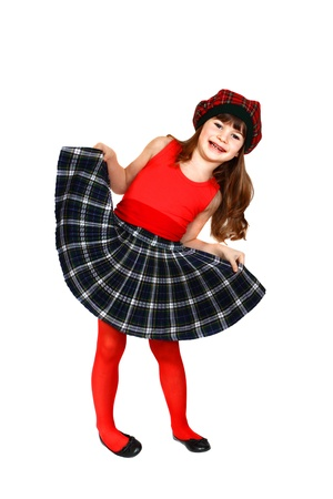Cute little girl dressed in Scottish style  Portrait isolated on white background Stock Photo