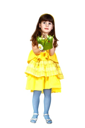 Cute little girl in yellow dress and blue stockings with easter bunny in hands. Full height portrait isolated on white background