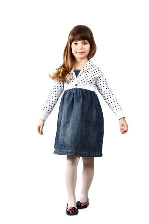 Cute little girl portrait in full height on white background