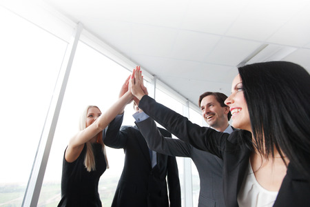 5: highfive in a business meeting