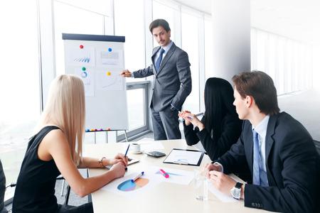businessman showing data on whiteboard