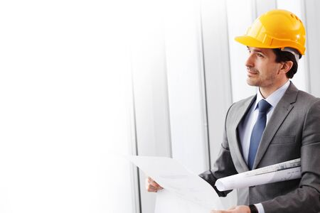 businessman in construction helmet thinking photo