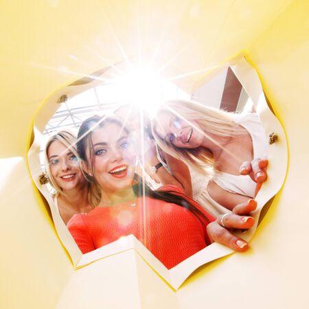 looking inside: beautiful young women looking inside bag Stock Photo