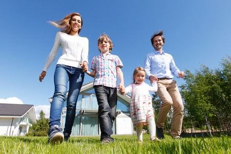 happy family running from the house Archivio Fotografico