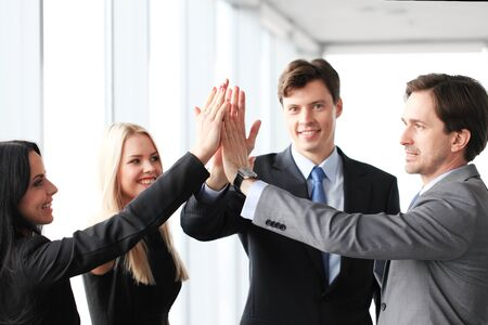 5: Happy business people hands giving high five