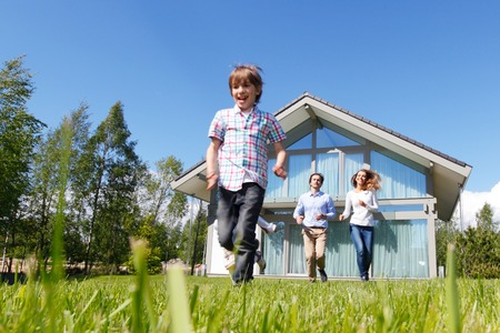 happy family running from the house Stock Photo